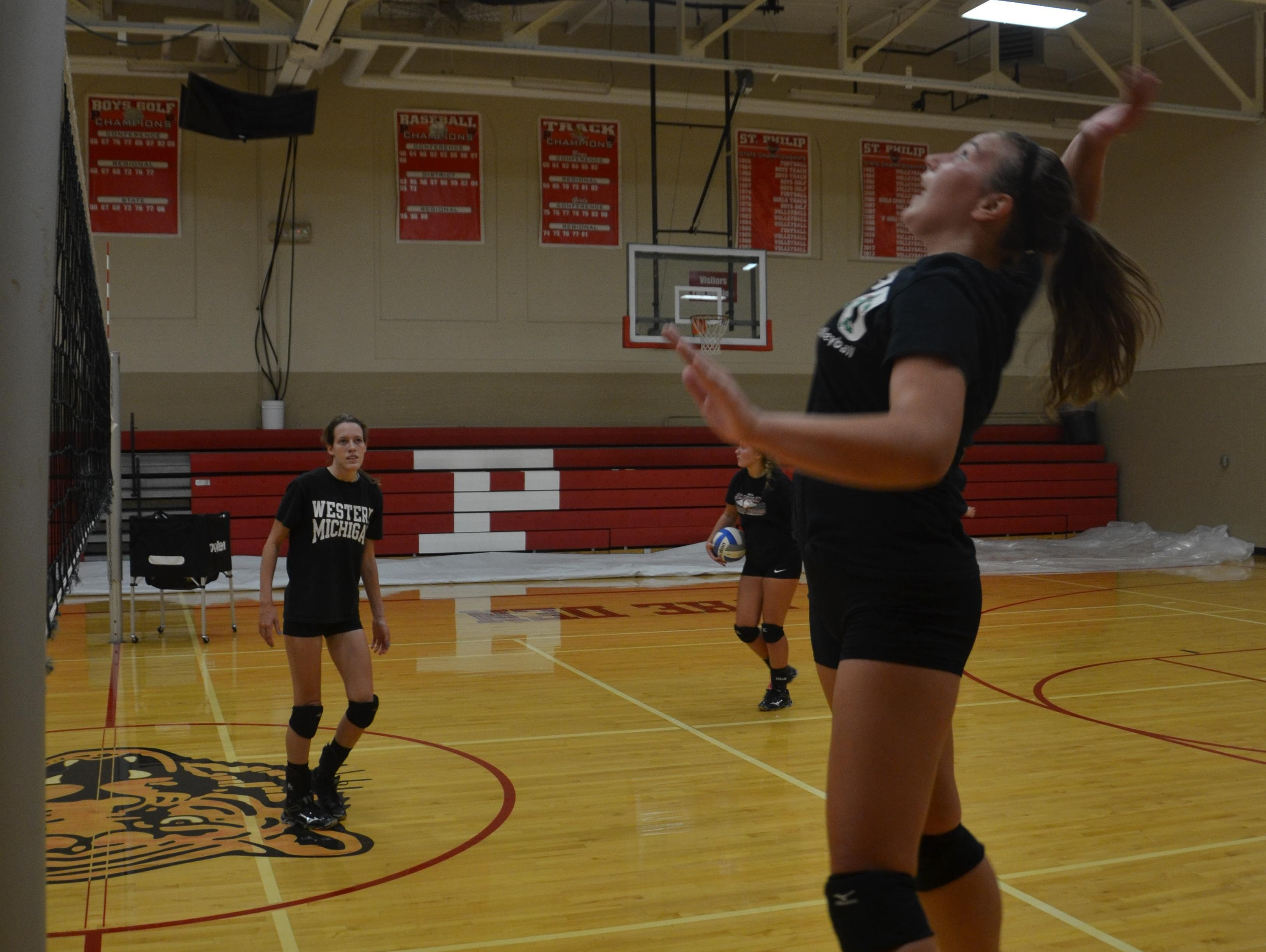 St. Philip's Anna Lehouiller goes for a kill during the first volleyball practice of the season on Wednesday.