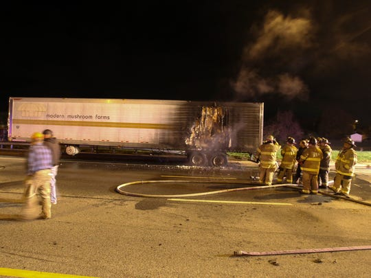 Firefighters work after extinguishing a fire in semi-trailer on westbound Kirkwood Highway near the Centerville Road overpass, reported shortly before 10:30 p.m. Tuesday.