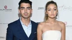 NEW YORK, NY - OCTOBER 08:  Joe Jonas (L) and Gigi