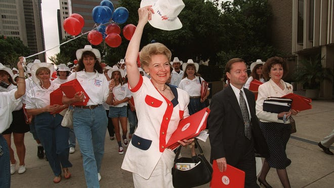 In this 1996 file photo, Republican National Coalition for Life Chairwoman Phyllis Schlafly leads her group to the Republican Platform hearing in San Diego on Aug. 6, just ahead of that year's Republican National Convention in the city.