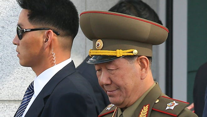 Hwang Pyong So, vice chairman of North Korea's National Defense Commission, arrives at the Incheon International Airport in Incheon, South Korea, on Saturday, Oct. 4, 2014.
