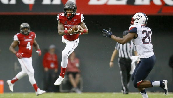 UC wide receiver Shaq Washington makes a catch over
