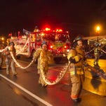 Check back following this year's Fantasy of Lights Parade Nov. 27th for photos from the event. The Howell High School Fire Academy wrapped fire hoses with lights to add a new twist to the 2014 Fantasy of Lights parade.
