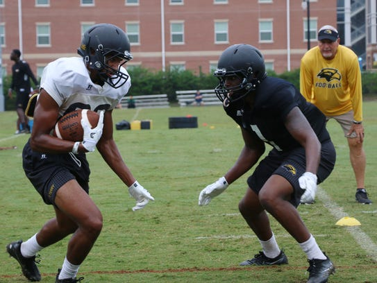 Southern Miss football players practice Thursday during