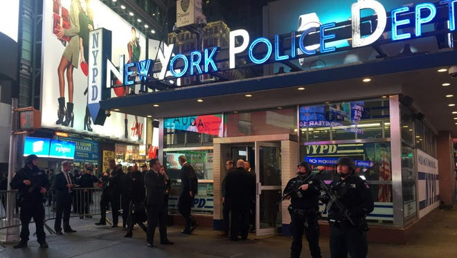 Police officers stand guard in Times Square on Nov. 18, 2015, in New York.