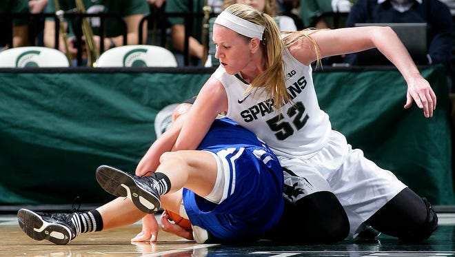 Michigan State's Becca Mills (52) and Grand Valley State's Meryl Cripe wrestle for the ball Sunday, Nov. 9, 2014, in East Lansing, Mich.
