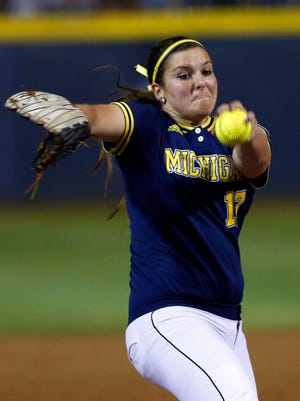 Michigan's Haylie Wagner pitches in the first inning against UCLA in the NCAA Women's College World Series softball game in Oklahoma City, Friday, May 29, 2015.