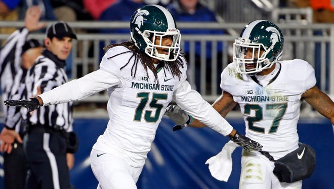 Michigan State cornerback Trae Waynes (15) celebrates with Kurtis Drummond (27) after intercepting a pass in the end zone for a touchback against Penn State on Nov. 29, 2014. Waynes has announced that he is leaving MSU for the NFL Draft.