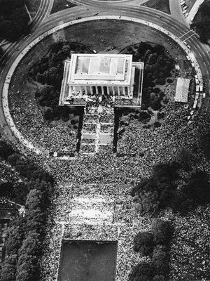 "An aerial view shows the 1963 March on Washington D.C. Ben Leuchter, editor of the Vineland Times Journal, described the scene of over 200,000 people as ""a vast sea of humanity."""