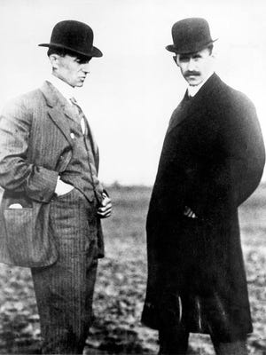 Wilbur Wright, left, and Orville Wright are shown in this undated file photo.The Wright brothers worked together to build and fly the first Wright Biplane, which made a successful flight on December 17, 1903 at Kill Devil Hills near Kitty Hawk, North Carolina. The Wright brothers have long been credited as the first to achieve powered flight. But in June, 2013, Connecticut Gov. Dannel P. Malloy signed a law giving credit to German-born aviator and Connecticut resident Gustave Whitehead. On Thursday, Oct. 24, 1013,Ohio state Rep. Rick Perales and North Carolina state Sen. Bill Cook held news conferences to dispute Connecticut's action and reassert the Wright Brothers were first in flight. (AP Photo/File)
