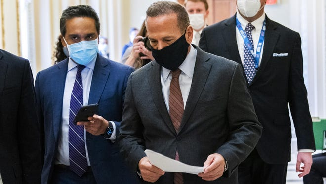 Rep. David Cicilline, D-R.I., is followed by reporters as he walks outside the House Chamber at the Capitol, Monday, Jan. 11, 2021, in Washington. Cicilline introduced a resolution including articles of impeachment for President Donald Trump over his role in the siege of the Capitol by Trump supporters Jan. 6.