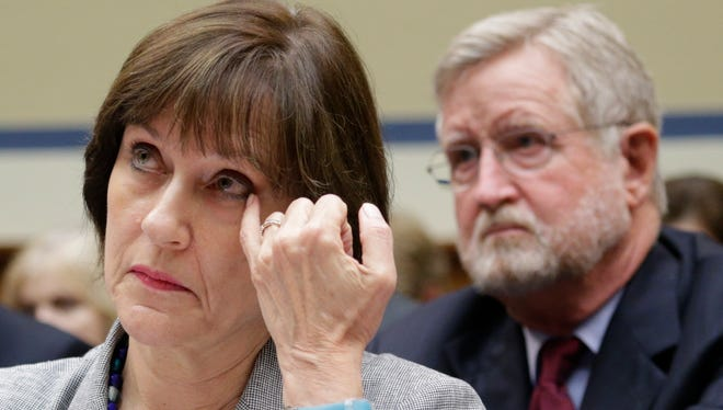 Lois Lerner, then-director of Exempt Organizations for the Internal Revenue Service, listens with her lawyer William Taylor, right, before invoking her Fifth Amendment right not to testify May 22, 2013.