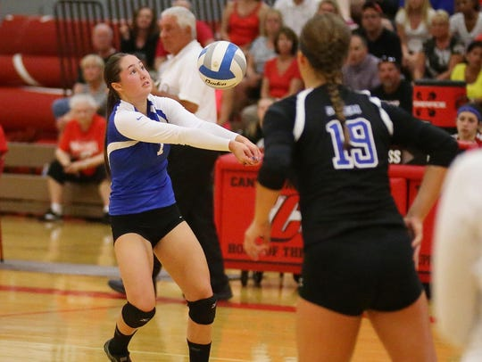 Salem setter Sara Soltis (No. 7) bumps the ball while