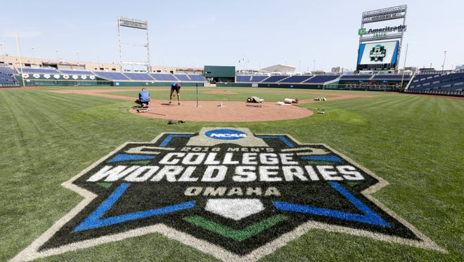 The College World Series logo is displayed behind home plate at TD Ameritrade Park in Omaha, Neb., Thursday, June 14, 2018, where the NCAA College World Series baseball tournament starts on Saturday, June 16. (AP Photo/Nati Harnik)
