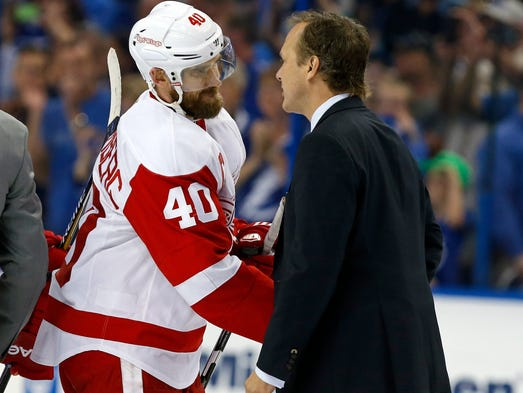 Red Wings captain Henrik Zetterberg shakes hands with
