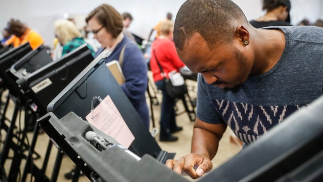 Elijah Ransom of Columbus, Ohio, votes early at the Franklin County Board of Elections, on Monday, Nov. 7, 2016,.