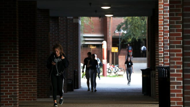 Students walk on FSU campus, one day after the university officially halted Greek life activities following the death of a student at an off-campus party.