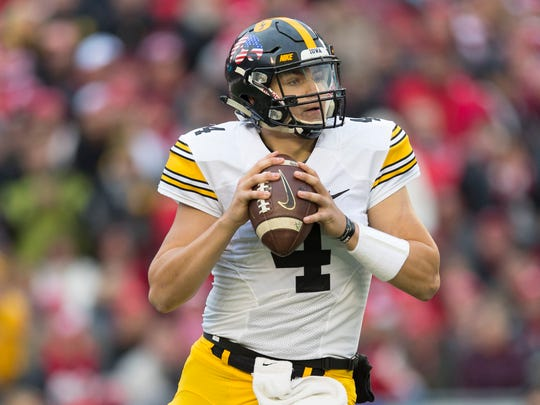 Nov 11, 2017; Madison, WI, USA; Iowa Hawkeyes quarterback Nathan Stanley (4) looks to pass during the first quarter against the Wisconsin Badgers at Camp Randall Stadium. Mandatory Credit: Jeff Hanisch-USA TODAY Sports