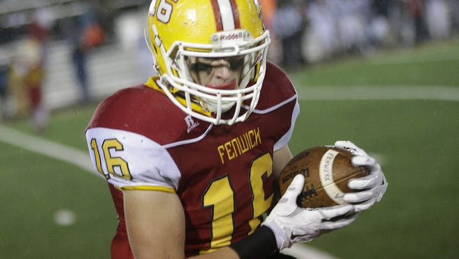 Fenwick's Alex Hemmelgarn catches a pass during the Falcons football game against Bishop Hartley, Saturday, Nov. 28.