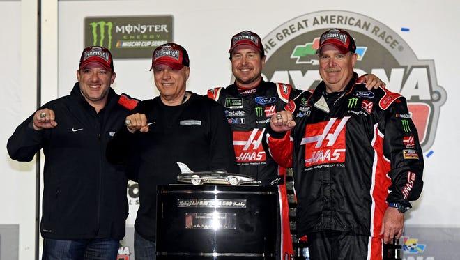 (From left to right) Stewart-Haas Racing co-owners Tony Stewart and Gene Hass, Daytona 500 champion Kurt Busch and crew chief Tony Gibson celebrate Sunday at Daytona International Speedway.