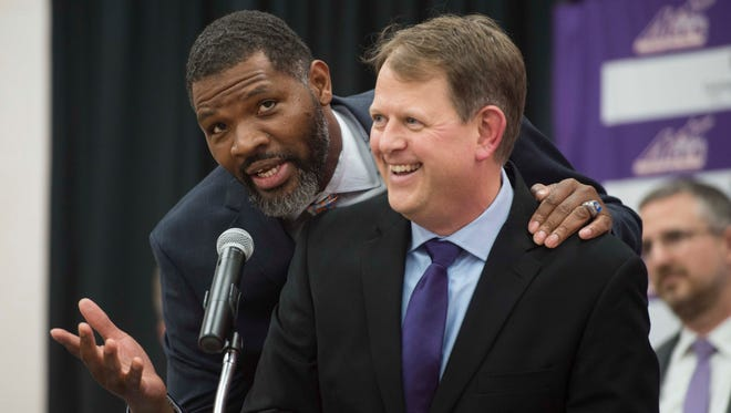 """University of Evansville head coach Walter McCarty interrupts UE Senior Associate Athletic Director Lance Wilkerson's closing remarks to remind fans to """"get on board"""" at Meeks Family Fieldhouse on Friday, March 23, 2018. McCarty, an Evansville native was announced as the new University of Evansville mens basketball coach Thursday."""