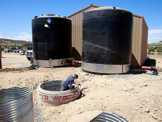 Russ Caskey, with contractor JCH, works July 22 on a new pump station for the Morningstar water system. An attorney for AV Water Co., which owns Morningstar, says the company may have secured a buyer for the system.