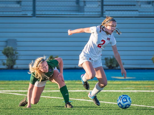 Northern Highlands senior Sarah Kelly (No. 2) takes the ball from Tara Walenczyk during the state finals Nov. 21, 2015.
