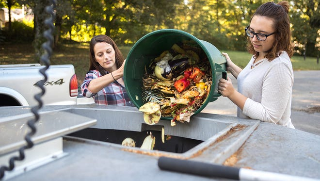 Director of The Center for ServiceñLearning & Community Engagement, Alexandra Wills and Student Worker, Leslie Warren demonstrate the new waste compost on campus on Friday, Sept. 29, 2017.