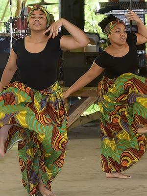 Students from P.J.'s Dance and Art School perform a traditional dance to begin the festivities of the annual Juneteenth Folklife Festival held Saturday at the William Guillory Farmers Market Pavilion in Opelousas. Other performers for the event were Geno Delafose and French Rockin Boogie, The Zydeco Ballers dance team and Mr. Goldman Thibodeaux. See more photos at dailyworld.com and on the Daily World Facebook site.