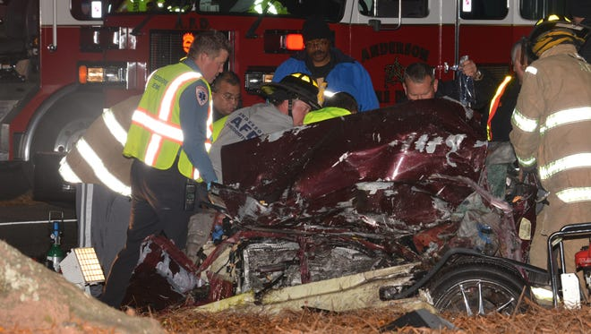 Firefighters had to extract the passengers out of a Nissan Altima after a deadly crash by Anderson University killed three people Saturday.