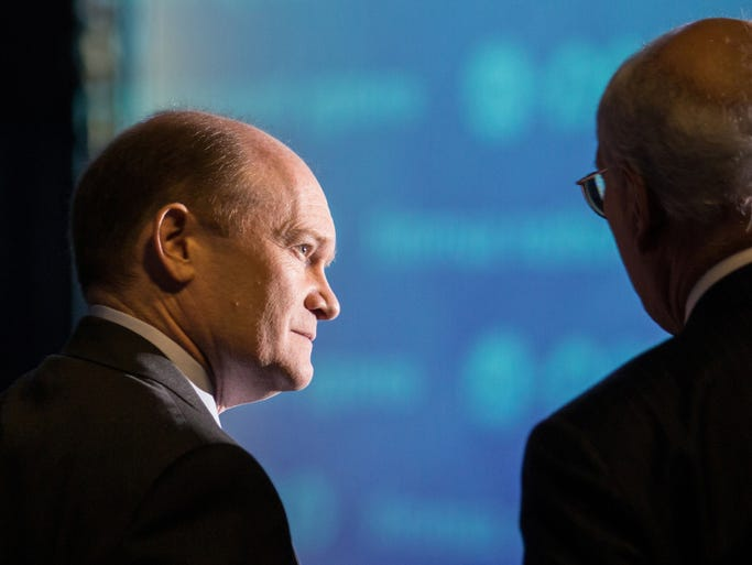 A photographer's flash illuminates U.S. Senator Chris Coons as he stands back stage with Congressman Paul Tonko before the two head out to speak at the ARPA-E Energy Summit at the Gaylord National Resort and Conference Center at the National Harbor.
