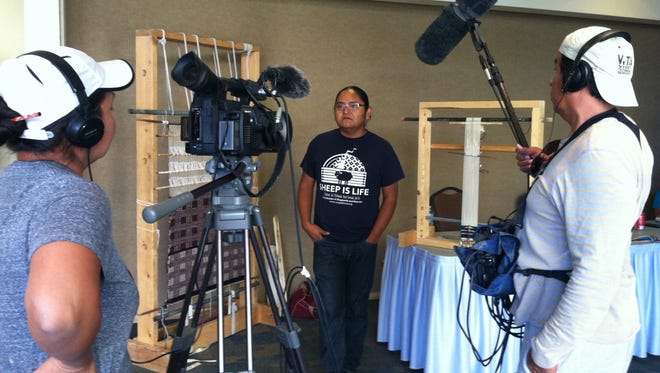 """Northern Diné Youth Committee member Eliseo Curley is interviewed by filmmaker Ramona Emerson in this production still from """"Mayors of Shiprock."""""""