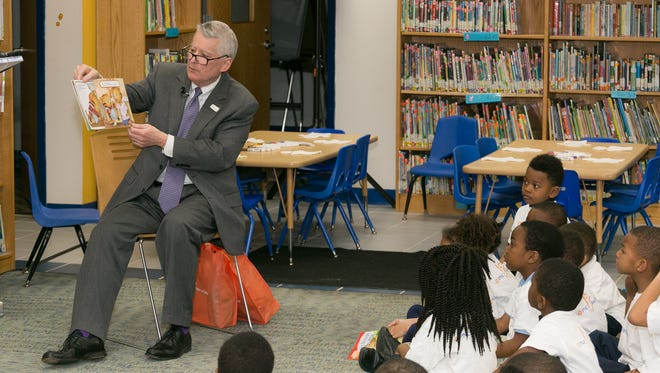 Ric DeVore reads to students at Schulze Academy for Technology and Arts in Detroit on April 4, 2017