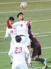 Cooper's Izac Faraci (8) heads the ball while teammates Narayan Bhujel (19) and Isiah Arratia (23) look on, along with Brownwood's Enrique Hernandez. Cooper beat the Lions 4-1 in the nondistrict soccer game Friday, Jan. 26, 2018 at Shotwell Stadium.