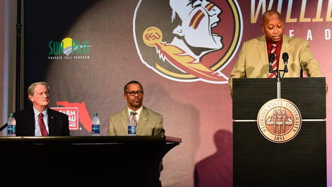 Florida State President John Thrasher (left) and head coach Willie Taggart listen to Athletic Director Stan Wilcox (right) during an introductory press conference at Doak Campbell Stadium.