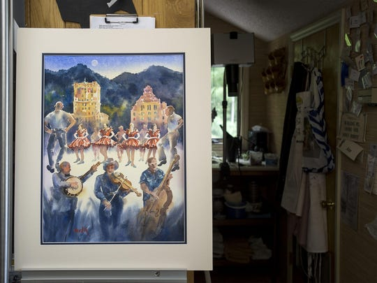 Watercolor artist Ann Vasilik's painting on display in her studio in North Asheville. The piece was commissioned by the Folk Heritage Committee for the anniversary of Shindig on the Green.