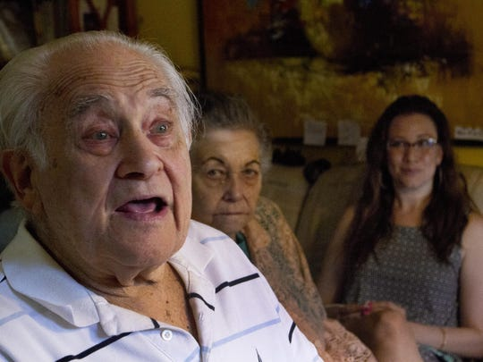 (Left to right) Albert Perdeck, his wife Elaine and grandaughter Whitney Ullman talk about how the Perdecks were scammed by callers who told them over the phone that they won the lottery.
