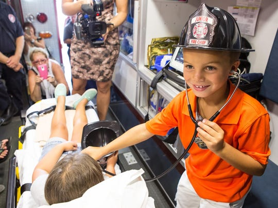 Mason Farr, 7, of Ocean City uses a stethoscope to listen to the heartbeat of Katherine Conway, 5, during a tour of the Ocean City Fire Department's Headquarters on Monday.