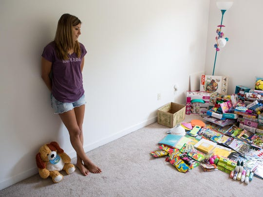 Toys donated from supporters partially fills a room in Alexa Shoultes' home. These items will eventually be given to Child Life and the Ronald McDonald House.