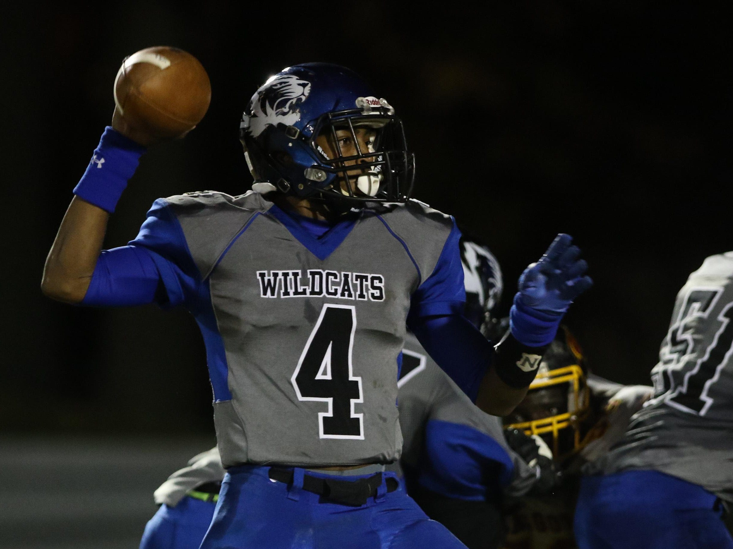 Howard quarterback Earnest Austin ran for three touchdowns as the Wildcats defeated Tower Hill 30-16 on Friday night.