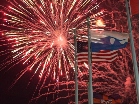 Fireworks frame the flags in Ocean City at North Division Street.
