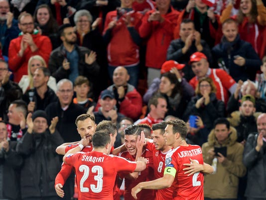 Switzerland's Steven Zuber, center, celebrates scoring with teammates during the 2018 World Cup group B qualification soccer match between Switzerland and Hungary in the St. Jakob-Park stadium in Basel, Switzerland, on Saturday, Oct. 7, 2017. (Jean-Christophe Bott/Keystone via AP)