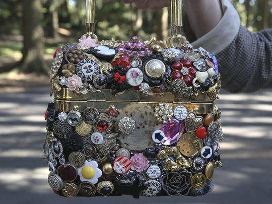 This Thursday, Sept. 19, 2019 photo shows a handmade handbag by Ilene Wood at her Lehigh Valley Estate in Emmaus, Pa. Ilene Hochberg Wood's collection of 3,000 handbags — the majority of which dwell in a 2,400-square-foot Quonset hut on her Lehigh Valley estate — will make a fashionista fall to her knees. ( Steve M. Falk/The Philadelphia Inquirer via AP)