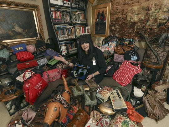 In this Thursday, Sept. 19, 2019 photo, Ilene Wood sits among her collection of handbags at her Lehigh Valley Estate in Emmaus, Pa. Ilene Hochberg Wood's collection of 3,000 handbags — the majority of which dwell in a 2,400-square-foot Quonset hut on her Lehigh Valley estate — will make a fashionista fall to her knees. ( Steve M. Falk/The Philadelphia Inquirer via AP)