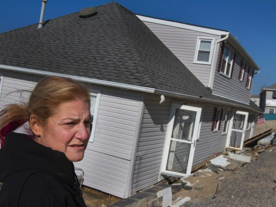 "Lisa Frankle stands outside her Ortley Beach condominium, which was flooded and knocked off its foundation by superstorm Sandy. Her home finally is being rebuilt finally. ""I am so excited you have no idea,"" Frankle said."