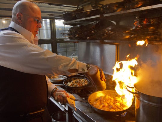 Christopher Mariani, owner and executive chef at Buona Sera restaurant in Red Bank, prepares Chicken Scarpariello.