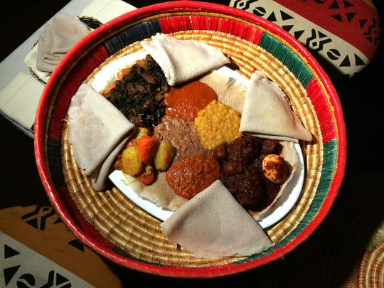 Injera bread with meat and vegetables at Makeda Ethiopian Restaurant in New Brunswick