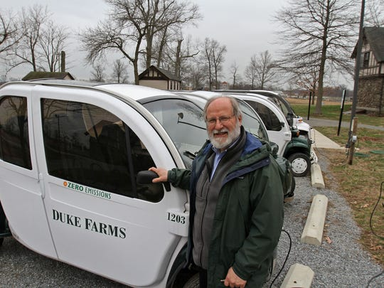 Michael Catania, executive director of Duke Farms in Hillsborough, shows off one of their fleet of 20 electric vehicles. Duke Farms models many examples of sustainable living.