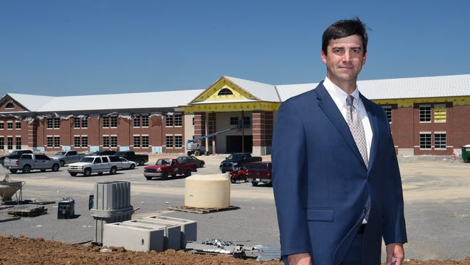 Nolensville High School Principal Bill Harlin stands in front the of future Nolensville High School, which will open fall 2016.