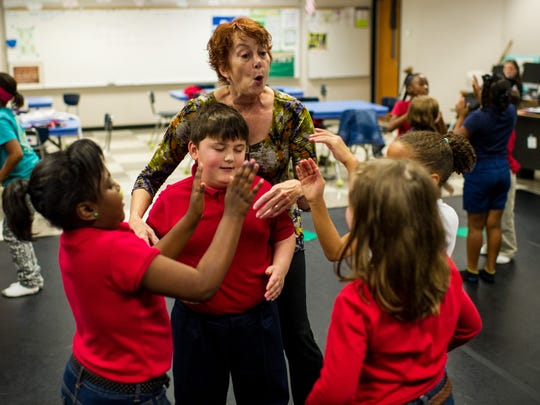 """Mary Francis """"Cissy"""" Whipp, center, leads a third grade class in a dance routine at J. Wallace James Elementary School in Lafayette, La., Thursday, Nov. 19, 2015."""
